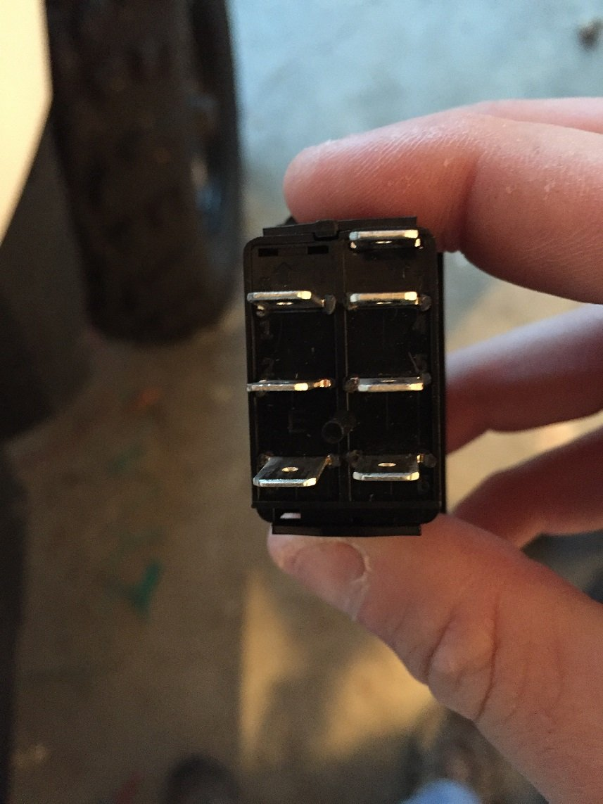 Help wiring a 7 pin    on off       on rocker    switch